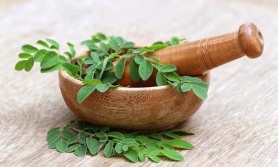 Moringa leaves and mortar pestle