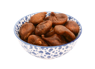 Whole dried figs in a blue and white china bowl