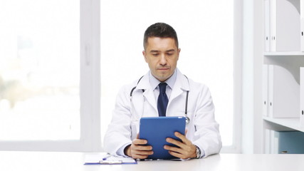 doctor with tablet pc and clipboard in hospital