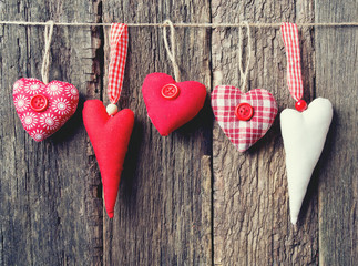 textile hearts on rustic wooden surface