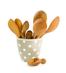 wooden kitchen utensil in a cup isolated on white