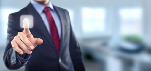 Man in office touching screen
