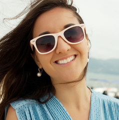 close up Happy woman near ocean