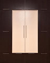 Brown and beige. modern wooden wardrobe. closed