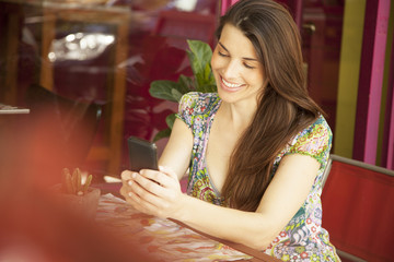 Beautiful Woman Smiling with Cel Phone