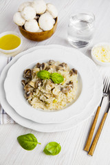 Risotto with mushrooms on white