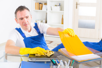 Dishonest man cleaner at the office