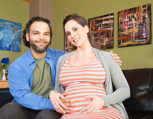 Smiling Man with Happy Expecting Woman
