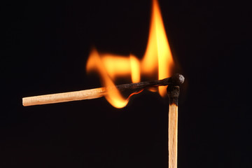 Two matches in flames