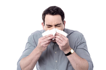 Sick man sneezing