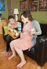 Pregnant Couple Eating Donuts