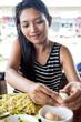 Asian woman peel egg shells