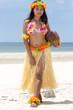 Hula Hawaii dancer with coconut walking on beach