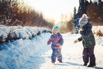 Two children in winter park