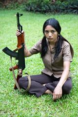 Asian woman with machine gun