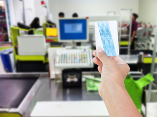 hand hold credit card on at cash register in supermarket