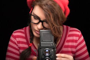 Young Woman Capturing Photo Using Vintage Camera