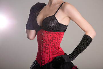 Young sexy woman in corset and bra