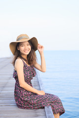 portrait of beautiful woman wearing long dress and straw hat loo