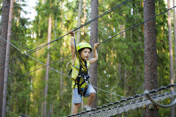 little cute boy in helmet runs track, leisure on nature extreme