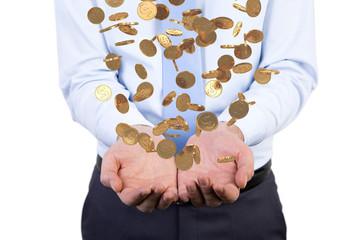 Businessman handing falling coins