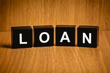 financial loan word on black block