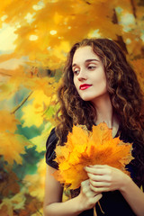 Autumn romantic portrait of beautiful girl with long hair