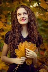 Autumn portrait of beautiful curly smiling girl