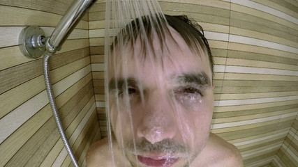 Man face in shower, slow motion