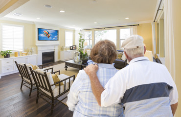 Senior Couple Overlooking A Beautiful Living Room