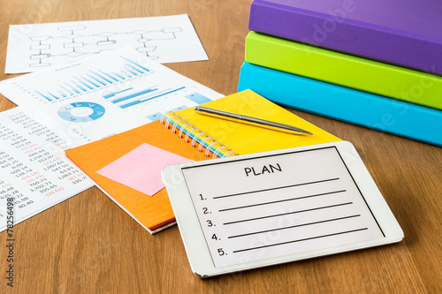 Digital tablet pc showing blank form of project planning - 78256498