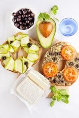 Healthy breakfast. Italian lunch. Sandwiches with avocado, olive
