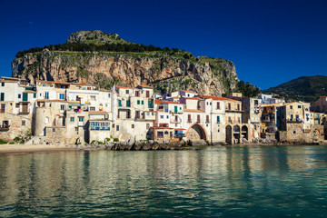 old houses and the mountain on a background in Cefalu