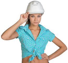 Pretty girl in shorts, shirt holding white helmet