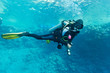 Female scuba diver underwater - 78257201