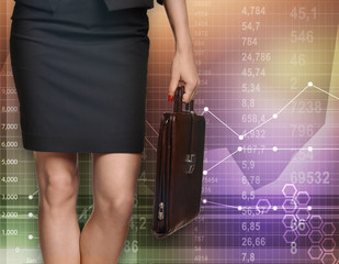 Business woman standing with a briefcase on background economic