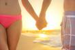 Love - romantic couple holding hands, beach sunset