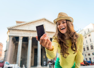 Closeup on woman making selfie in front of pantheon in Rome