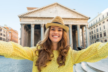 Happy woman making selfie in front of pantheon in rome