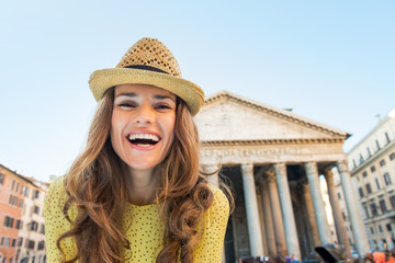 Portrait of happy young woman near pantheon in rome, italy