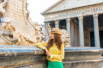 Young woman near fountain of the pantheon in rome, italy