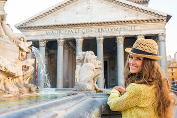Portrait of happy woman near fountain of the pantheon  in Rome