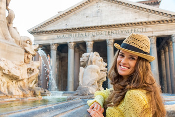 Portrait of smiling woman near fountain of the pantheon in Rome