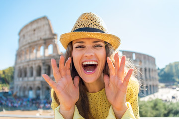Happy woman shouting through megaphone shaped hands  in Rome
