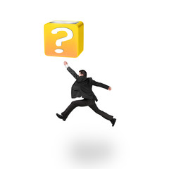 Jumping businessman hitting 3d question mark box isolated on whi