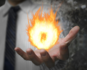 Burning fire ball in man's hand