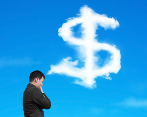 Businessman thinking about dollar sign shape cloud with blue sky