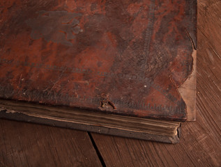 Ancient book on the old wooden table