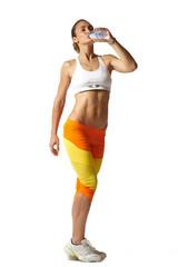sporty muscular woman drinking water