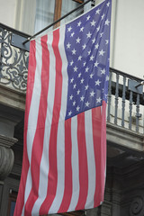 Usa American flag waving from italian balcony